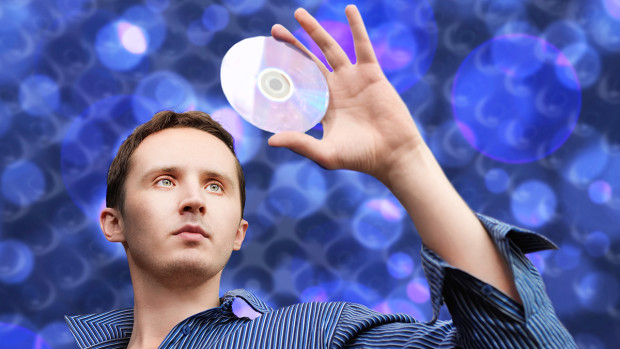Man with compact disc in his hand